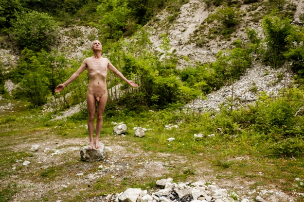 Nude male in the environment
